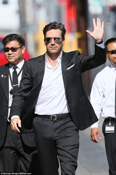 Suited up: The 44-year-old looked sharp in a tailored black two-piece suit which was teame...