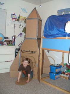 CRAFT friend Stacey Gordon& son and husband made this cardboard rocket ship from a big box. I remember being thrilled at the prospect of cardboard forts f Cardboard Forts, Cardboard Rocket, Cardboard Crafts, Cardboard Spaceship, Kids Crafts, Space Crafts For Kids, Diy For Kids, Forts En Carton, Outer Space Theme