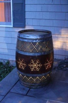 Turn a wine barrel into an outdoor porch light. Beautiful! The snowflake design can be changed to anything you want.
