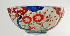 """Chinese Imari Porcelain Bowl Floral Decoration. A Chinese Imari, fluted edge porcelain bowl with floral and duck decoration. Height: 4 1/8"""" Diameter: 9 3/4"""""""