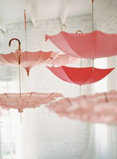 Adorable hanging pink umbrellas. Anne Robert Photography