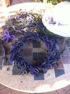 Making fresh lavender head-wreaths.