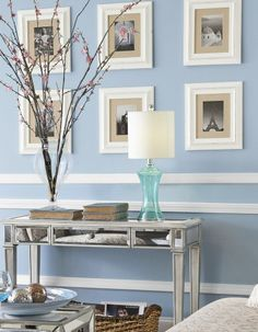 Photo frames displayed evenly and symmetrically create a clean look