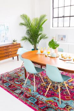 Come get inspired with these amazing mid-century modern rug designs at http://essentialhome.eu/