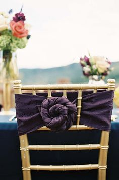 Knotted purple chair linen. Michelle Leo Events. Photography: Chudleigh Weddings - chudleighweddings.com  Read More: http://www.stylemepretty.com/destination-weddings/2014/01/21/rustic-park-city-wedding-at-canyons-resort/