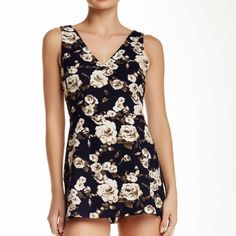 Navy blue romper New navy blue tank romper looks like a skirt in the front but is actually shorts zips up in the back light weight perfect for spring and summer Lush Shorts