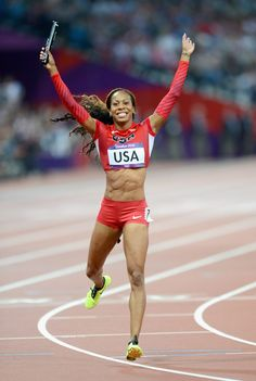 London 2012 - Sanya Richards-Ross runs anchor for team USA and crosses the line celebrating victory in the women's 4x400m relay final at the Olympic Stadium on August 11, 2012. 2012 Getty Images