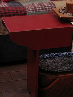 Loving the red table AND quilted chair behind it.