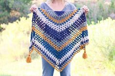 Worked in a vintage-inspired, boho color palette of LB Collection Merino Yak Alpaca, this crochet triangle scarf pattern is a versatile piece that'll keep you cozy until the tulips start blooming again. Free crochet pattern and video tutorial!