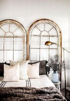 Vintage rustic window panes as a make-shift headboard.