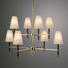 Ventana Chandelier - We think this lighting fixture is fantastic. The Ventana eight lamp chandelier retains a retro edge while being thoroughly modern. Sophisticated yet playful. Black with either polished nickel or antiqued brass accents. Heather oatmeal fabric shades. $795