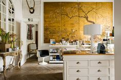 love the unexpected addition of gold Chinoiserie inspired art in a traditional-meets-modern space.