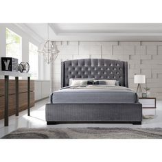 Luxurious velvet wing back bed frame with high tufted headboard.