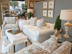 Slipcovered white and grey furniture at our Dallas showroom #slipcovers #chic #white #grey #livingroom