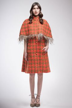 Orange and brown pied de coque coat in pure wool sleeveless with cape and brown feathers