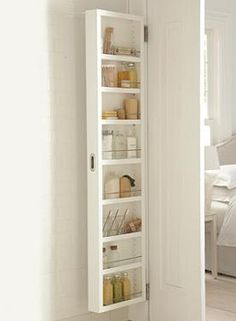 Discretely store your bath essentials with the Seven-shelf Storage Cabinet
