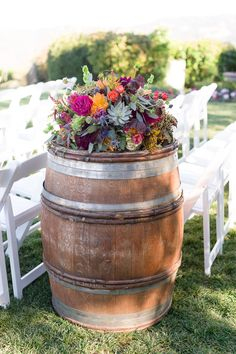 Winery wedding + barrel florals | Photography: Gavin Farrington Photography - gavinfarrington.com Read More: http://www.stylemepretty.com/california-weddings/2014/04/30/rustic-fall-wedding-at-thomas-fogarty-winery/