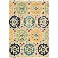 Stylishly anchor your living room seating group or master suite ensemble with this artfully hand-tufted wool rug, showcasing an exotic suzani medallion motif.  Product: RugConstruction Material: 100% WoolColor: IvoryFeatures:   Stain resistant        Handmade  Note: Please be aware that actual colors may vary from those shown on your screen. Accent rugs may also not show the entire pattern that the corresponding area rugs have.Cleaning and Care: Professional cleaning recommended. Rug pad recom…