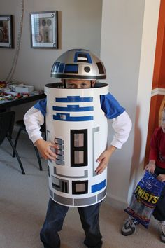 My husband created this awesome R2D2 costume for our son.  It was a huge success!  The hat - an old globe cut in half bolted to an old bike helmet.