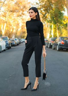 """For an office holiday party, blogger Sazan Hendrix put together an all-noir combo that works for a full 12-hour day. """"It's comfy and chic—you can never go wrong with black."""" Every single piece can be mixed throughout your full wardrobe, but stacked together it's a glam look.  H&M silk blouse, $60, hm.com; Gucci chain wallet, $895, gucci.com; Nine West pumps, $79, amazon.com; COS trousers, $99, cosstores.com"""