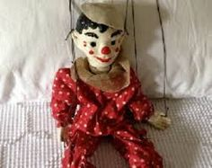 old clown marionette.