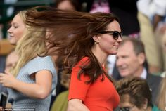 Feeling breezy: The Duchess of Cambridge's hair blew in the wind as she left the Royal Box of Centre Court due to rain