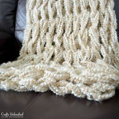 Check out this arm knit blanket made with Homespun Thick & Quick by Crafts Unleashed!  This arm knitting trend is still going strong!