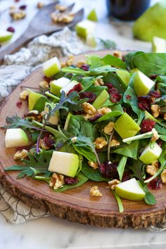 This Cranberry Spinach Salad is filled with slightly sweet pears, tart dried cranberries, creamy blue cheese and honey pecans! A sweet and savory salad that is on your table in 5 minutes!