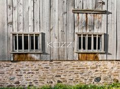 wooden window gates - Two windows gated by wooden bars