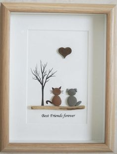 This is a beautiful small Pebble Art framed Picture of a Dog and Cat - Best Friends forever handmade by myself using Pebbles, Driftwood and Wooden Heart Size of Picture incl Frame : approx. 22cm x 17cm  Thanks for looking Doris   Facebook: https://facebook.com/Pebbleartbyjewlls4u      Product Code: P - Blue