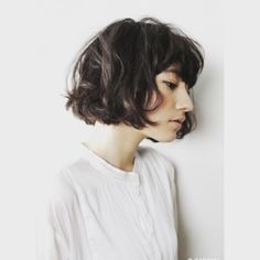 Favorite haircut of the day. Wavy, blunt bob with thick, wavy blunt bangs. So…