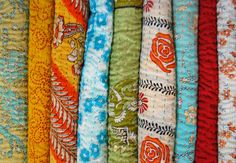 Anchal - textiles. quilts made by fair-trade artisans in India. Made from 100% recycled cotton sari.