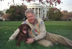 Photograph of President William (Bill) Jefferson Clinton with Buddy the Dog, 04/06/1999