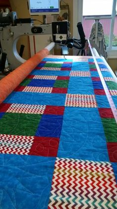 Fun throw for a boy. Quilted in southwestern design and pale blue thread. Customer thread.