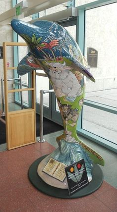"""A Dolphin Can Take You to Where the Wild Things Are"" is located at the Clearwater Public Library, 100 No. Osceola Avenue, downtown Clearwater.  Sponsored by the Downtown Development Board, the artist was Cathie Carol Zurich Wus."