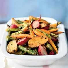 Roasted vegetables in Garlic Expressions,  easy and flavorful. Made in Perrysburg, Ohio, Garlic Expressions is a truly unique, 100% natural product perfect as a salad dressing or marinade.