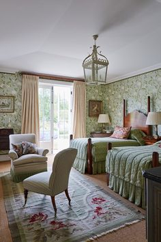 Discover bedroom design ideas on HOUSE - design, food and travel by House & Garden including this room with Colefax and Fowler fabric curtains.