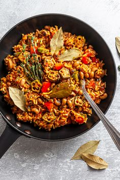 Our vegan Nigerian Jollof rice recipe is a well-balanced one-pot meal prepared with a spicy pepper and tomato sauce, black-eyed peas, and okra. vegan nigerian jollof rice,african rice jollof,healthy african recipes,african rice recipe,easy jollof rice recipe #vegan #govegan #dairyfree #glutenfree #recipe #cooking #food Easy Rice Recipes, Tasty Vegetarian Recipes, Pescatarian Recipes, Veggie Recipes, Healthy Recipes, African Rice Recipe, Jollof Rice, Rice Ingredients, High Fiber Foods