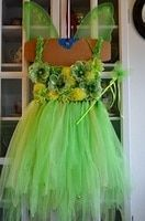 Tinkerbell skirt : use the tutu I have already, add the tulle for additional length and add a top, embellish as shown Tinkerbell Costume Toddler, Tinkerbell Party, Tangled Party, Diy Tutu, Robes Tutu, Tutu Dresses, Green Tutu, Tinker Bell Costume, Dora