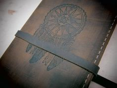Leather journal or sketchbook featuring  free personalization dreamcatcher. $25.00, via Etsy.