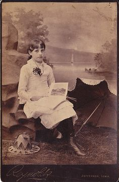 Girl with Picture Book. A cabinet photo by Reynolds of Jefferson, Iowa