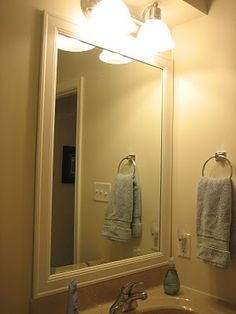 Framed mirrors in bathrooms. Use stained trim/wood. See also bowerpower.com for the other bathroom.