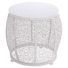 Crafted from iron and showcasing a delicate scrollwork design, this lovely white end table is perfect for resting your apres-work cocktail in the sunroom or ...