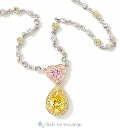 The Ziamond cubic zirconia Lianna Necklace showcases a pink heart cz and a canary yellow pear cz in 14k gold.  $1995 #ziamond #cubiczirconia #cz #necklace #pear #heart #canary #14kgold