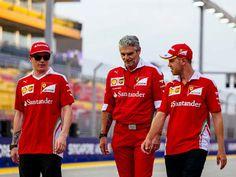 Kimi Raikkonen, Maurizio Arrivabene, and Sebastian Vettel, Scuderia Ferrari, Japanese Grand Prix, 2016.