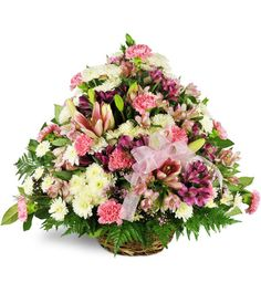 Convey your heartfelt condolences to friends and family with this lush  sympathy basket. Soothing pinks, purples, yellows and whites spring from  a rustic wicker basket in the form of mums, alstroemeria and mini  carnations. This sweet sympathy gift is appropriate for remembering men  or women of all ages and includes tasteful seasonal greenery and ribbon  bow.This funerary arrangement features a round brown wicker basket, mums,  alstroemeria, and pink mini carnations arranged with greenery…
