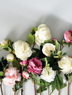 If you want to make an eye-catching display, OKA's faux peonies are not only stunning but their large heads quickly fill up a vase, making them excellent value.