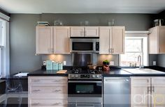 gray kitchen, white cabinets