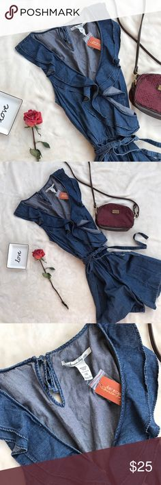 NWT American Rag Jean Romper Super cute and girly with some flare! Has small tear (see pic) otherwise great condition! Button in back at neck. Tie belt included. Size 0X American Rag Pants Jumpsuits & Rompers