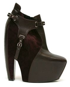 Google Image Result for http://intheircloset.com/wp-content/uploads/2009/07/balenciaga-fall-2006-harness-platform-boots-black.jpg